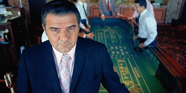Jimmy The Greek with a roulette table