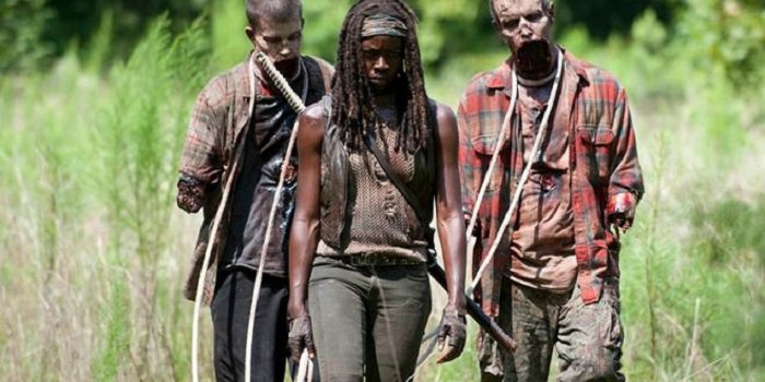 Michonne from Walking Dead walking with two zombies