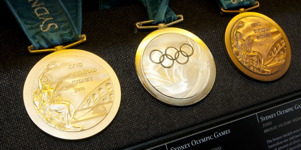 Olympics, olympic gold, Olympic medals, Olympic gold medal, gold, silver, bronze, gamingzion.com, online sports books, online betting, betting on line, IOC, Vancouver 2010 Olympic and Paralympic Winter Games, 2008 Beijing Games, St. Louis Games, International Olympic Committee